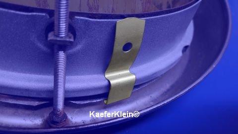 Halteklammer für Scheinwerferring / Scheinwerferreflektor für stehende Scheinwerfer, orig VW